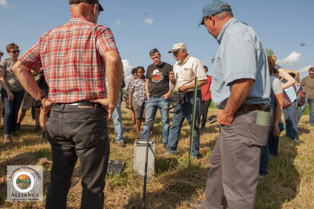 Learning about on-farm conservation activities on PrairiErth Farm. Photo credit: Piero Taico.